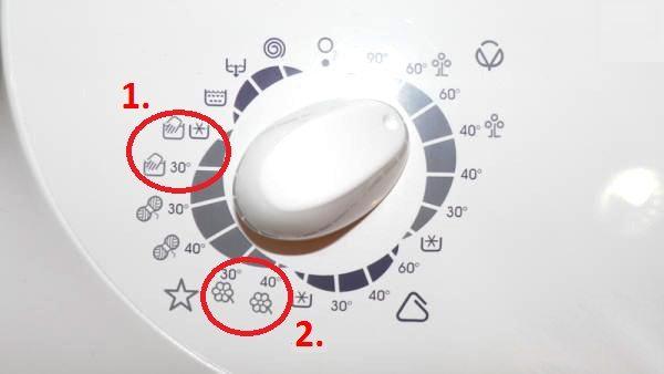 значок на стиральной машине Занусси