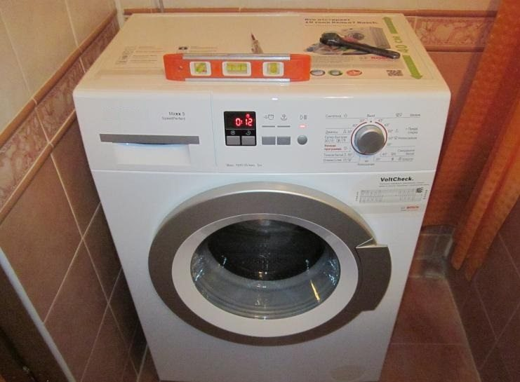 установка стиральной машины по уровню