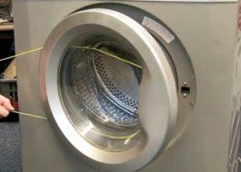Как открыть дверь стиральной машины Канди?