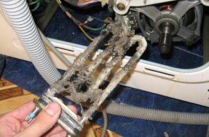 Как вытащить ТЭН со стиральной машины?