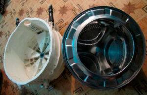 Как достать барабан из бака стиральной машины