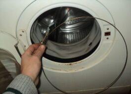Как надеть пружину на барабан стиральной машины?